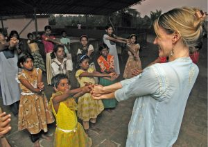 Kristin Cooper at the Homes of Hope working to connect, volunteers, donors, yoga students and yoga teachers with the people who need their help, both at home and abroad.